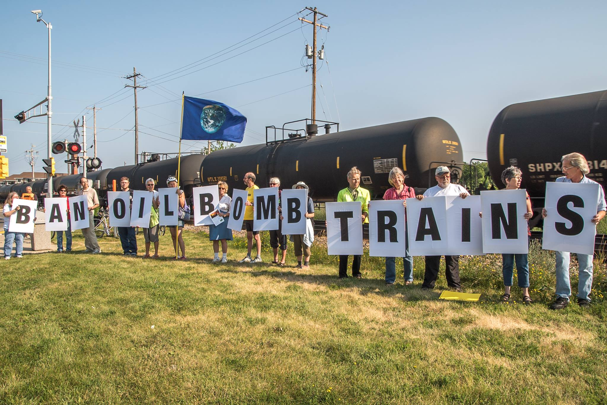 Members of this Daylight Brigade in Wauwatosa bring visibility to the issue of bomb trains.