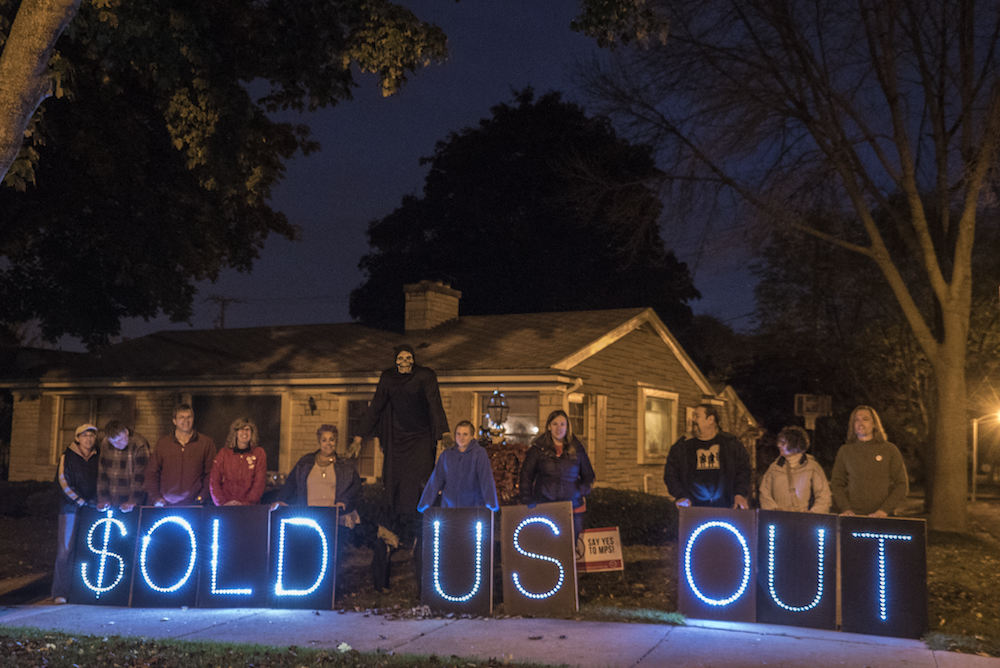 Former Wendell Harris supporters held this Overpass Light Brigade message outside his house on Friday night during the neighborhood's trick or treating event. Lots of Wendell's neighbors now know about his selling out to Milwaukee's education privatizers.