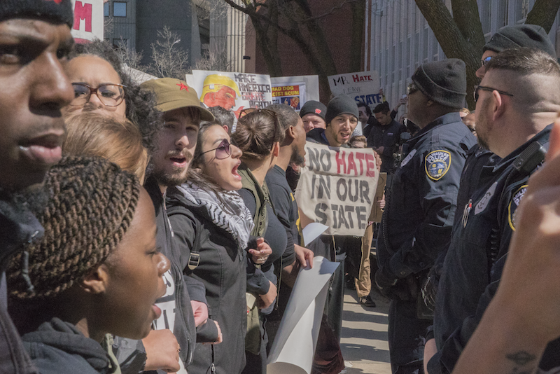 The line between upset students and nervous police was tense (photo credit: Joe Brusky).
