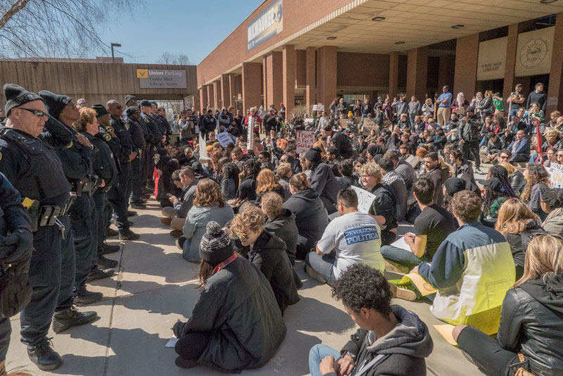 After a protester was mysteriously apprehended and detained the students sat down stating they wouldn't leave until the arrested student was released (photo credit: Joe Brusky).