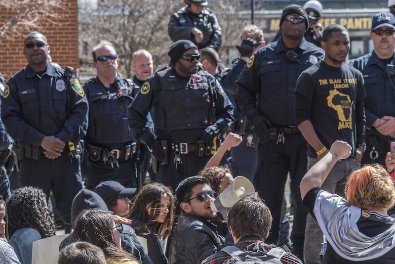Student leaders called on others to call the police department and demand the arrested activist be released (photo credit: Joe Brusky).