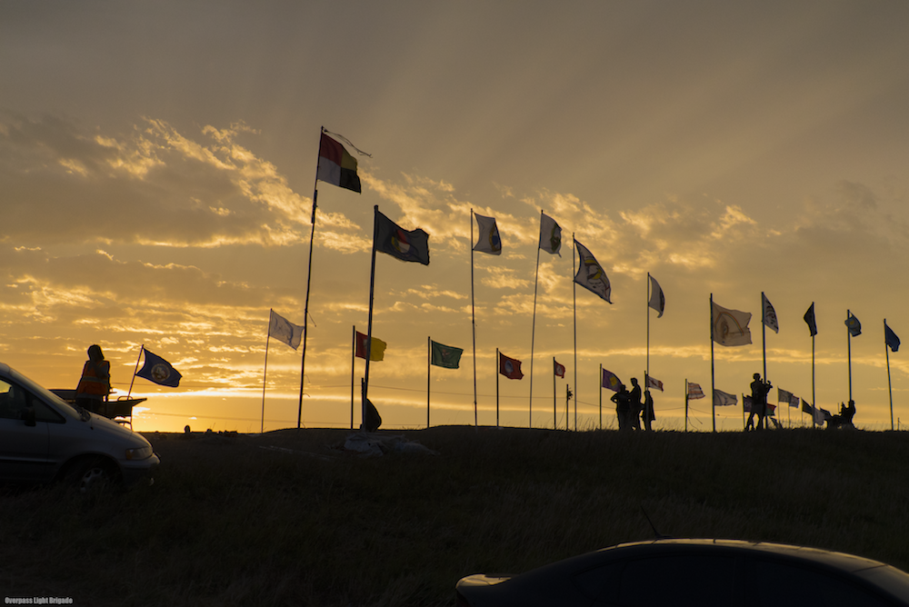 The flags of indigenous nations line the entrance of Sacred Stone Camp.
