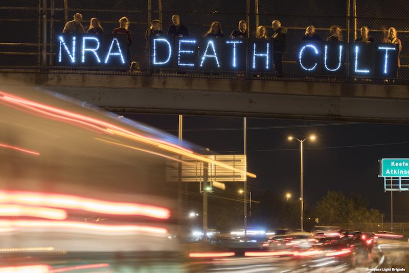 Ring Street Pedestrian Bridge message over I-43 in Milwaukee (Photo Joe Brusky). & Death Cult America | Overpass Light Brigade